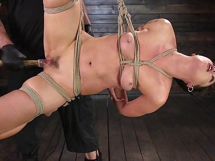 Bondage extreme for the submissive whore with trimmed cunt