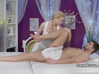 Blonde masseuse rides big cock